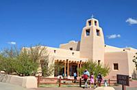 people leaving church (Santa Maria de la Paz, Santa Fe, New Mexico) after Mass.