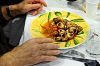 A plate of freshly cooked escargots (snails), a French favorite food.