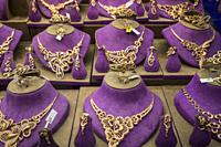 Gold jewellry for sale in the gold markets of the old town souk of Dubai, UAE, Middle East.