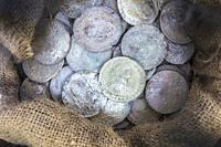 Sack full of recovered silver spanish coins recovered from sunken ship. ARQUA Museum, Spain.