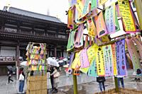 Visitors hang their wishes on bamboo in commemoration of Tanabata festival at Zojoji Temple on July 07, 2019, Tokyo, Japan. Every year, people write t...