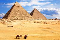 View on the Pyramid of Khafre and the Pyramid of Khufu, desert of Giza, Egypt.