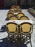 outdoor cafe tables and chairs, Salers, Cantal Department, Auvergne-Rhône-Alpes, France.
