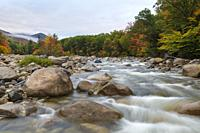 Autumn foliage along the East Branch of the Pemigewasset River in Lincoln, New Hampshire during the autumn months.