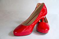 Pair of red high heel shoes.