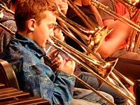 6th Grade Boy Playing Trombone in Band, Wellsville, New York, USA.
