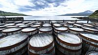 View of whisky barrels at Bunnahabhain Distillery on island of Islay in Inner Hebrides of Scotland, UK.
