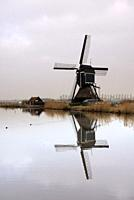 The Achterlandse windmill along the canal called Ammersche Boezem near Groot-Ammers in the Dutch region Alblasserwaard.