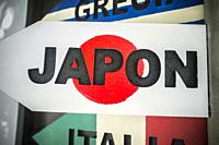 Pole guidepost with Japan sign and flag as background. Travel concept.
