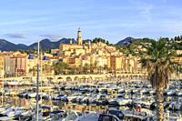 France, Alpes Maritimes, Menton, the Vieux Port and the old town dominated by the Saint Michel Archange basilica.