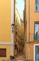 France, Alpes Maritimes, Menton, narrow street in the old town.