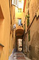 France, Alpes Maritimes, Menton, alley with steps in the old town.