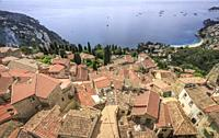 France, Alpes Maritimes, Roquebrune Cap Martin, overhead view on houses roofs and Roquebrune Bay.