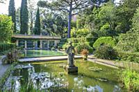 France, Alpes Maritimes, Menton, jardin Serre de la Madone (Serre de la Madone garden), basin, statue and warm greenhouse (obligatory mention of the g...