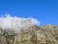 Table Mountain covered by by clouds during a strong South East wind. This is know as The Tablecloth that covers the table.