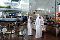 Doha, Qatar - Passengers at Hamad International Airport.