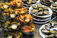 Seafood. Oysters, shrimps and whelks at the Marché des Capucins market. Bordeaux, Gironde. Aquitaine region. France Europe.