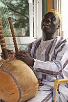 Senegalese musician playing kora