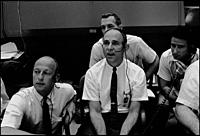USA Houston -- 20 Jul 1969 -- Four members of the prime and backup crews for Apollo 12 monitor activity the first moon landing mission - Apollo 11 - f...