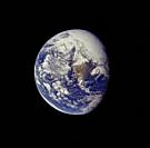 EARTH -- 16 Apr 1972 -- A view of the Earth photographed about one and one-half hours after trans-lunar injection. Although there is much cloud cover,...