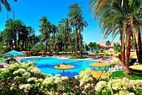Swimming pool complex of the Mercure Hotel on the banks of the Nile, Karnak near Luxor, Upper Egypt, Egypt