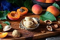 Apricot kernels and fruit on a table.