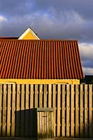 Hirtshals, Denmark The lines of a roof and wall at sunset.
