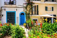 Ibiza Eivissa downtown Dalt Vila flower facades in Balearic Islands.