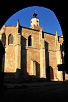 Saint Mary la Mayor church from the arch of the town hall. Coca, Segovia. Spain.