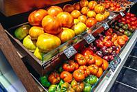 Vegetable stall on Mercado de San Anton in neighborhood of Chueca, Madrid, Spain.