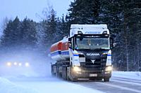 Salo, Finland - January 18, 2019: Next Generation Scania R520 tank truck of MM Tolvanen for Sava Group haulage on the road at dusk in winter snowfall.