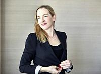 Woman in office wearing blazer