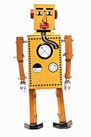 Vintage tin robot toy isolated on a white background.