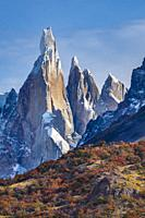 Cerro Torre and fall color in the lenga tree forest in Parque Nacional Los Glaciares, Patagonia, Argentina. .