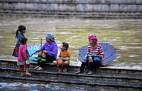Flower Hmong (hill tribe) girls and women in Sa Pa square, Lao Cai Province, Vietnam, Asia.