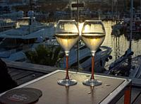 PALMA DE MALLORCA, SPAIN - JUNE 23, 2019: Two champagne flute glasses Veuve Cliquot at sunset by the marina in sunshine romantic on June 23, 2019 in M...