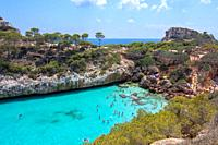 CALO DES MORO, MALLORCA, SPAIN - JULY 27, 2019: Small extremely turquoise bay and steep cliffs on a sunny day on July 27, 2019 in Calo des Moro, Mallo...