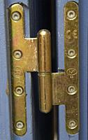 brass door hinge, Forcalquier, Provence, France.