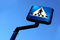 Blue and white crosswalk sign tilted view.