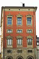 Old baroque architectural style burgundy coloured building with rows of fancy windows, Stockholm, Sweden, Europe.