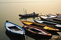 Man rowing on the Ganges river ( Varanasi, India).