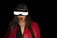 Technology woman using glasses to simulate alternate reality with surprise living experience of augmented reality looking the environmental changes.