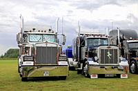 Alaharma, Finland. August 9, 2019. Classic American Kenworth W900B and Peterbilt 359 big rigs with shiny chrome lined up on Power Truck Show 2019. Cre...
