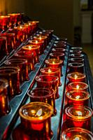 Votive candles or prayer candles in St Patricks Catholic Church in Newport in County Mayo Ireland.