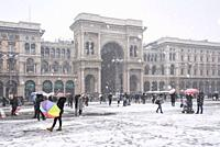 The gallery of Vittorio Emanuele II and Piazza Duomo in winter during snowfall, Milan, Lombardy, Italy, Europe.