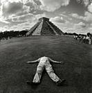 Tourist having a rest at Chichen Itza pyramid.