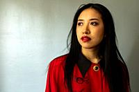 Tilburg, Netherlands. Studio portrait of a beautiful, Korean female student.