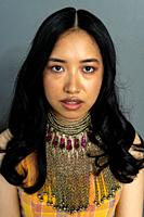 Tilburg, Netherlands. Studio portrait af a young, Korean woman with vintage, iron necklase.