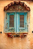 Curious window in Manarola housing. Cinque Terre.