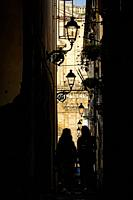 Syracuse, Sicily, Italy Two women walking down a narrow alley.